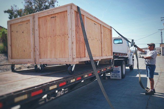 wooden containers being loaded on truck