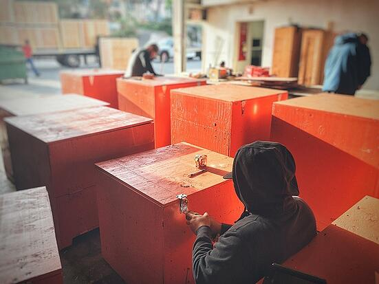 reusable shipping crates-being-assembled