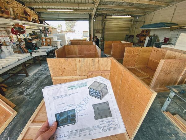 shipping_crates_being_assembled